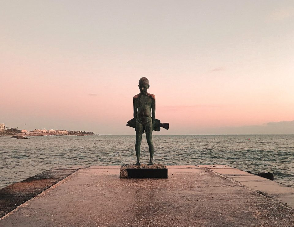 The young boy and the big fish is a bronzed sculpture of Yiota Ioannidou, located in Kato Paphos promenade, Cyprus